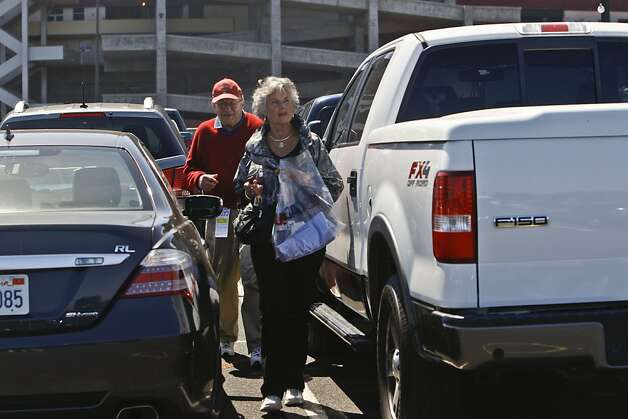 Erin Rohde, right, and Jim Rohde look for their car in The Candlestick Park after watched U.S. Open on June 13, 2012, San Francisco, Calif. Photo: Yue Wu, The Chronicle