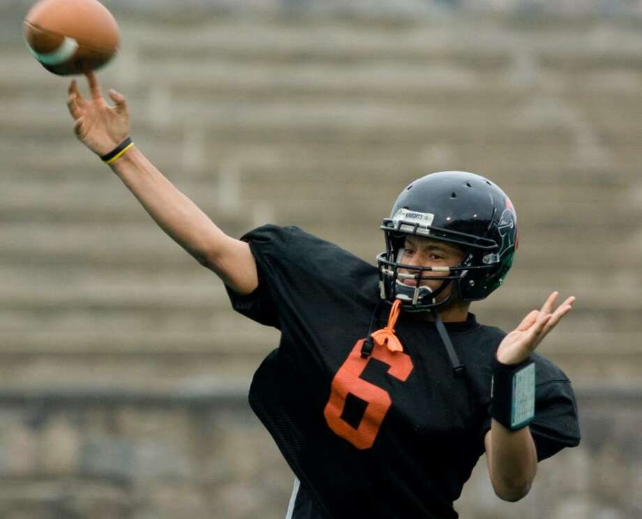 Stamford High School's quarterback Jalen Holmes practices with the football team in preparation for the Thanksgiving Day game against Westhill High School. Photo: Kerry Sherck / Stamford Advocate Freelance