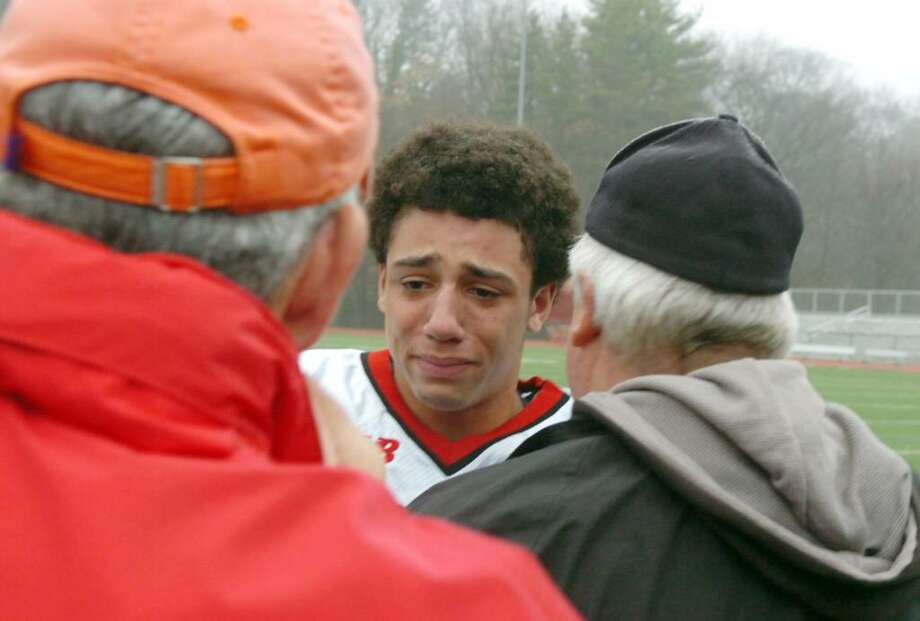 Greenwich High School football captain Camryn Ferrara leets his emotions go as the annual burning of the shoes ceremony wraps up. The ceremony is symbolic of how no one can ever fill the shoes of the graduating seniors. Photo: Keelin Daly / Greenwich Time