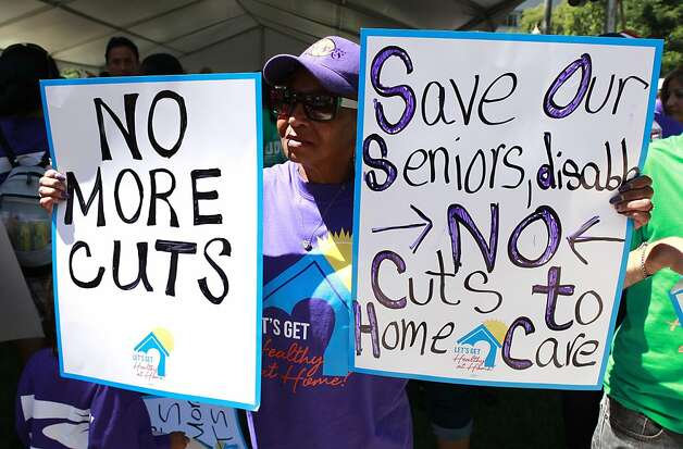 Christine Miles, of Los Angeles, an in-home service provider, join hundreds of others in a demonstration against proposed state budget cuts to social services, at the Capitol in Sacramento, Calif., Wednesday June, 13, 2012.  More than 40 home care workers,  the disabled and supporters were arrested during a second day of protests against Gov. Jerry Brown's proposal to cut $225 million from the state's In-Home Supportive Services program, which provides care for the sick and disabled in their homes.(AP Photo/Rich Pedroncelli) Photo: Rich Pedroncelli, Associated Press
