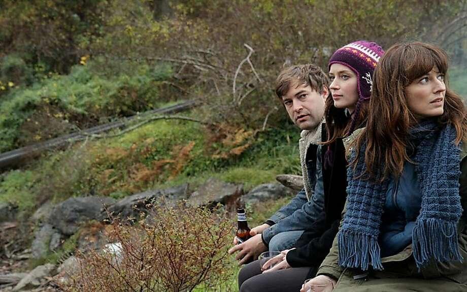 Mark Duplass as Jack, Emily Blunt as Iris, and Rosemarie DeWitt as Hannah in Lynn SheltonÕs YOUR SISTERÕS SISTER. Photo: Steven Schardt, IFC Films