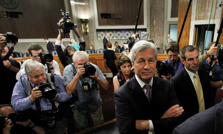 JPMorgan Chase CEO Jamie Dimon, head of the largest bank in the U.S., arrives to testify on Capitol Hill in Washington, Wednesday, June 13, 2012, before the Senate Banking Committee, about how his company recently lost more than $2 billion on risky trades and whether its executives failed to properly manage those risks. (AP Photo/Haraz N. Ghanbari) Photo: Haraz N. Ghanbari, AP / AP