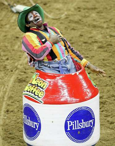 Barrel man Leon Coffee, of Blanco, performs during the bull riding event during the San Antonio Stock Show & Rodeo on Sunday, Feb. 19, 2012, at the AT&T Center. Photo: Edward A. Ornelas, San Antonio Express-News / © SAN ANTONIO EXPRESS-NEWS (NFS)