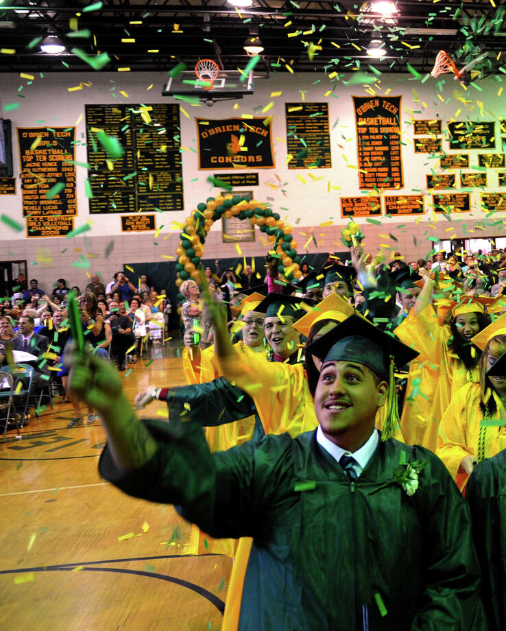 Graduate Devin Rodriguez throws confetti into the air as he and his classmates celebrate, during Emmett O'Brien Technical High School's Class of 2012 Graduation Ceremony in Ansonia, Conn. on Wednesday June 13, 2012. Photo: Christian Abraham / Connecticut Post