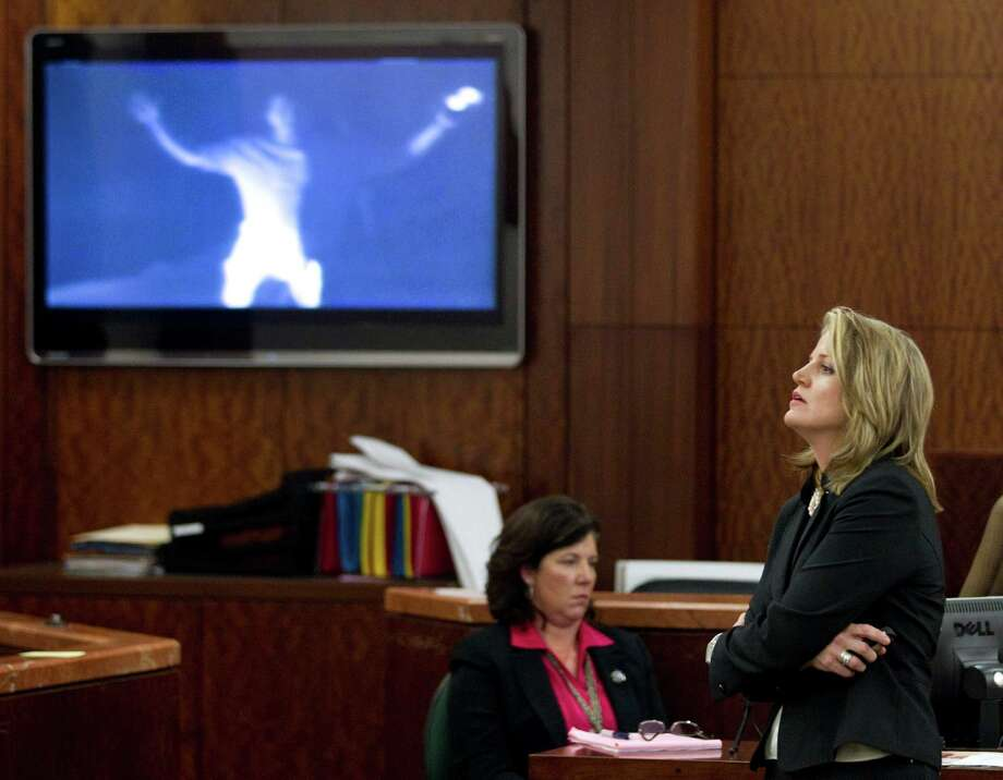Prosecutor Kelli Johnson pauses as she shows a video during closing arguments in the trial against Raul Rodriguez Wednesday, June 13, 2012, in Houston. Photo: Brett Coomer, Houston Chronicle / © 2012 Houston Chronicle