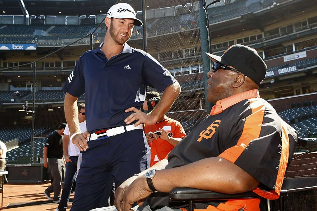 Golfer Dustin Johnson (left) talking with Willie McCovey at AT&T ballpark in San Francisco, California, on Wednesday, June 13, 2012.