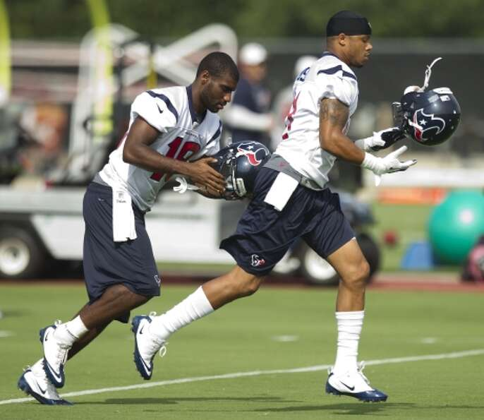 Wednesday, June 13Houston Texans wide receivers Lestar Jean, left,