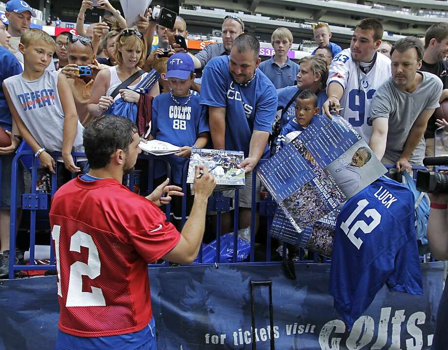 Indianapolis Colts quarterback Andrew Luck signs autographs for fans following NFL football practice Wednesday, June 13, 2012, in Indianapolis. (AP Photo/Darron Cummings) Photo: Darron Cummings, Associated Press
