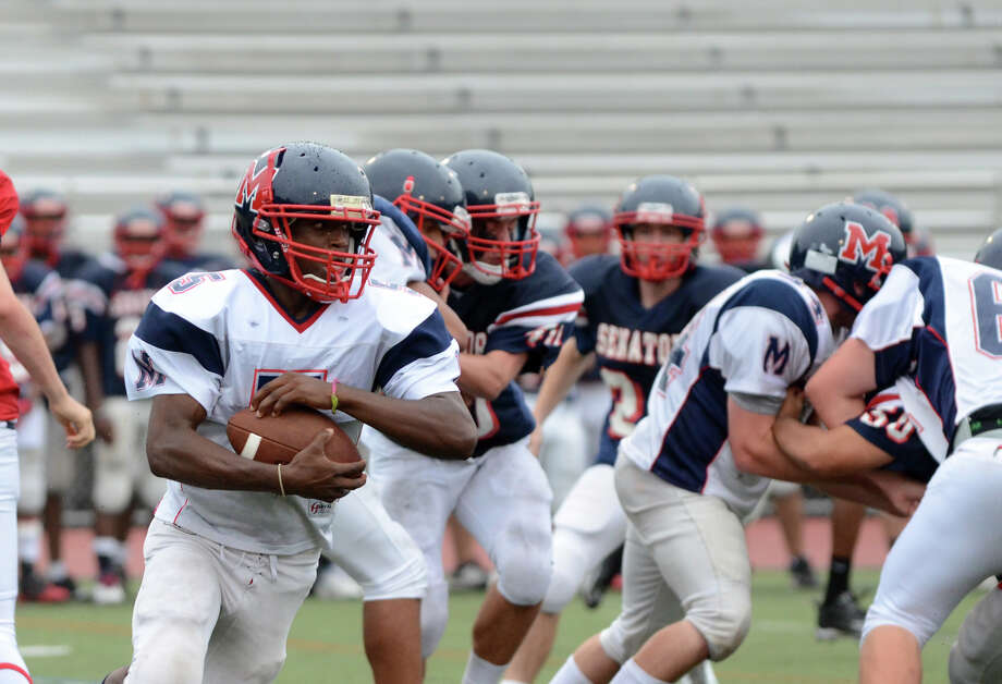 Trey Forney (5) carries the ball for the White Warriors during the Brien McMahon spring football game at Brien McMahon High School on Wednesday, June 13, 2012. Photo: Amy Mortensen / Connecticut Post Freelance