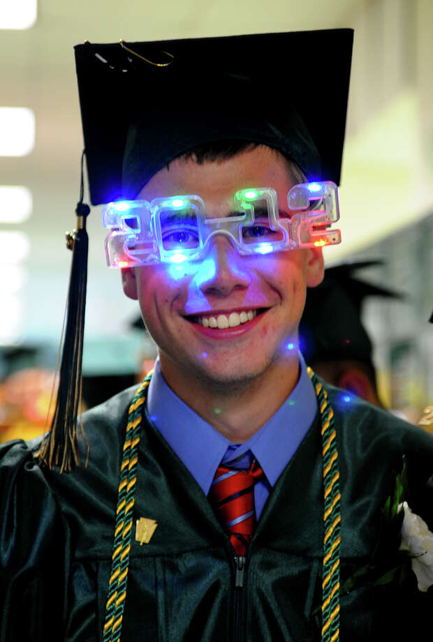 Graduate Russell Molnar sports a pair of 2012 glasses, during Emmett O'Brien Technical High School's Class of 2012 Graduation Ceremony in Ansonia, Conn. on Wednesday June 13, 2012. Photo: Christian Abraham / Connecticut Post
