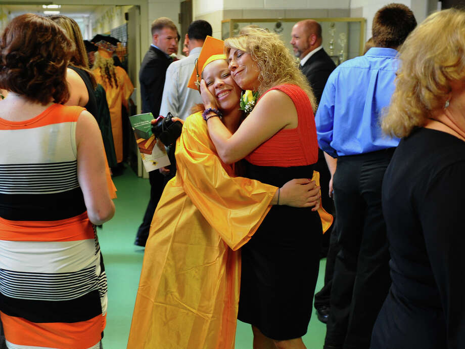 Teacher Annette McCabe hugs student Diandra Blizzard, during Emmett O'Brien Technical High School's Class of 2012 Graduation Ceremony in Ansonia, Conn. on Wednesday June 13, 2012. Photo: Christian Abraham / Connecticut Post