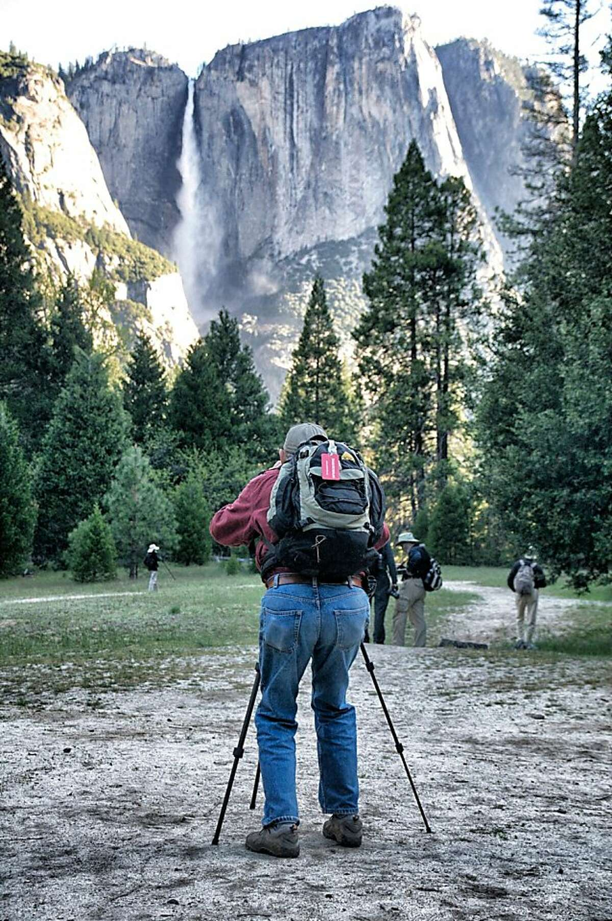 A Road Scholar participant takes aim at Yosemite Falls. Photo by John Flinn / Special to The Chronicle