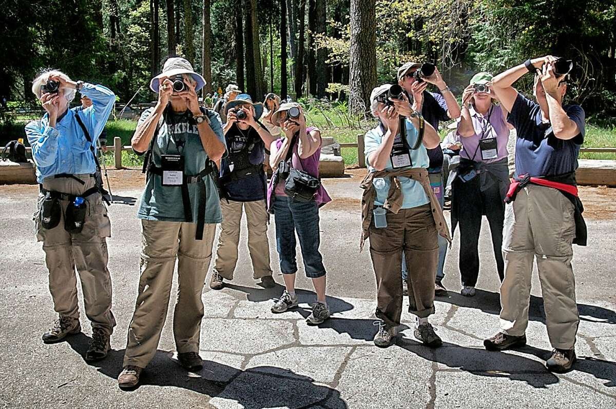 Road Scholar photo workshop participants take aim at Yosemite Falls. Photo by John Flinn / Special to The Chonicle