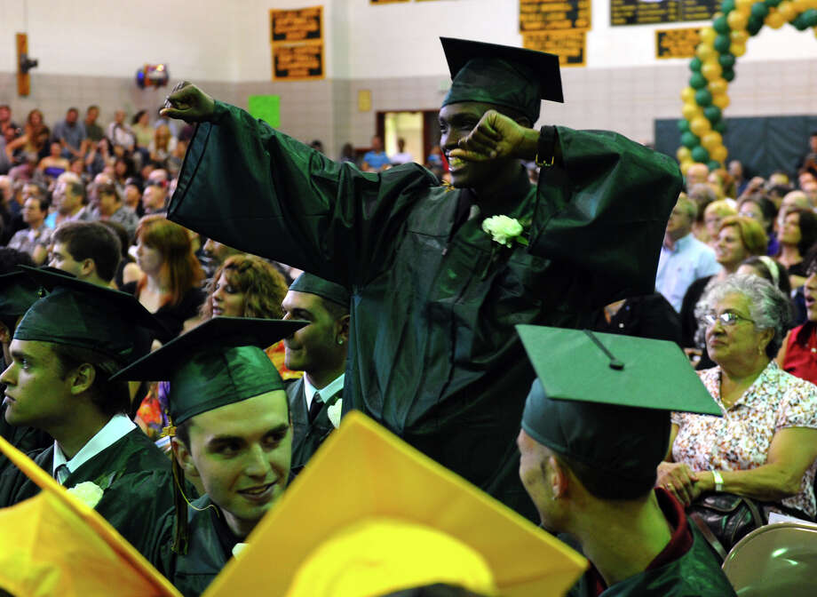 "Graduate Dondre Joyner dances while the song ""The World's Greatest"" by R. Kelly is performed, during Emmett O'Brien Technical High School's Class of 2012 Graduation Ceremony in Ansonia, Conn. on Wednesday June 13, 2012. Photo: Christian Abraham / Connecticut Post"