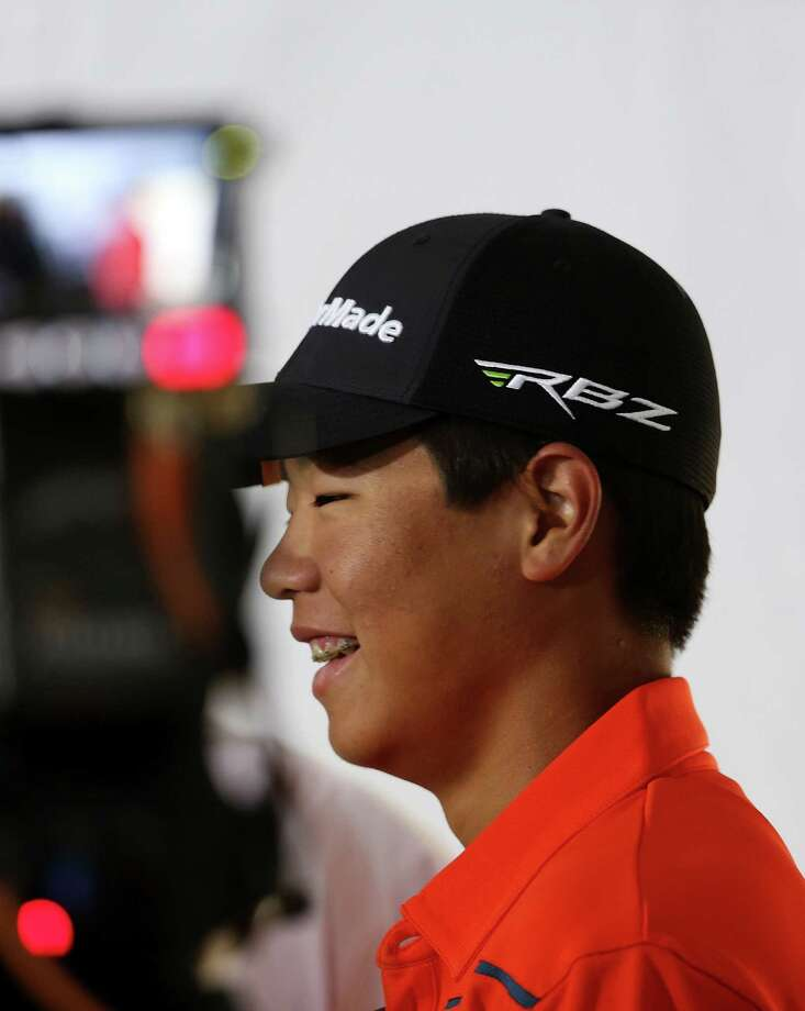 SAN FRANCISCO, CA - JUNE 13:  A TV crew films Amateur Andy Zhang of China after a press conference during a practice round prior to the start of the 112th U.S. Open at The Olympic Club on June 13, 2012 in San Francisco, California.  (Photo by David Cannon/Getty Images) Photo: David Cannon
