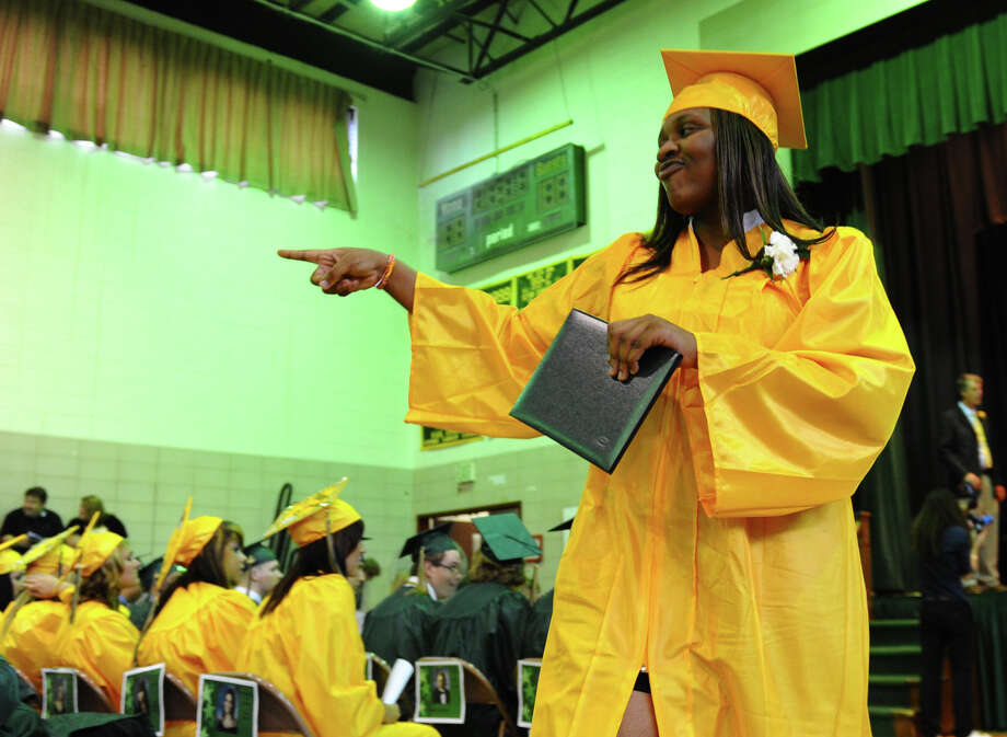 Graduate Shyanne Johnson points to a classmate after getting her diploma, during Emmett O'Brien Technical High School's Class of 2012 Graduation Ceremony in Ansonia, Conn. on Wednesday June 13, 2012. Photo: Christian Abraham / Connecticut Post