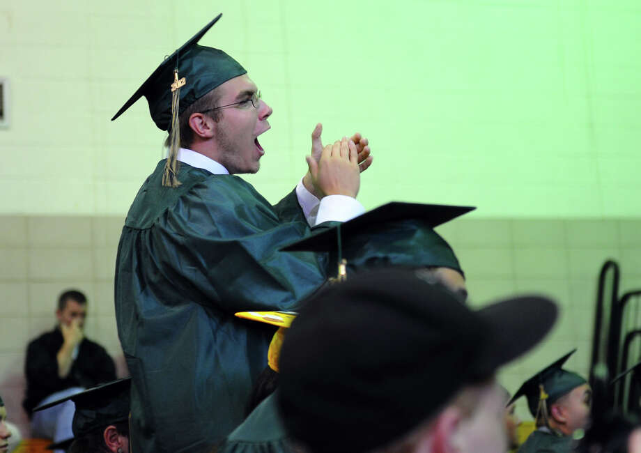 Graduate Anthony Merritt cheers for a classmate, during Emmett O'Brien Technical High School's Class of 2012 Graduation Ceremony in Ansonia, Conn. on Wednesday June 13, 2012. Photo: Christian Abraham / Connecticut Post