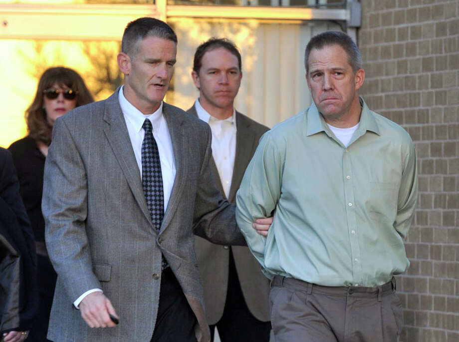 """FILE - In this April, 2, 2012 file photo, JetBlue pilot Clayton Frederick Osbon, right, is escorted by FBI agents as he is released from The Pavilion at Northwest Texas Hospital in Amarillo, Tex.  Ten passengers filed a lawsuit, Wednesday, June 13, 2012 in Garden City, N.Y. against JetBlue over the flight during which Osbon had to be physically restrained after after running through the cabin yelling about Jesus and al-Qaida during a New York-to-Las Vegas flight in March.They claim the airline was """"grossly negligent"""" in allowing him to fly. (AP Photo/Amarillo Globe-News, Michael Schumacher, File)    MANDATORY CREDIT; MAGS OUT; TV OUT Photo: Michael Schumacher"""