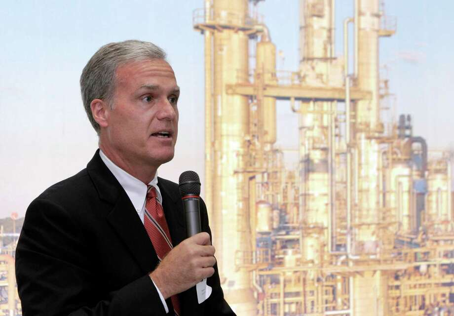 Pete Cella, CEO of Chevron Phillips Chemical, speaks during the groundbreaking for a Baytown plant. The background is a backdrop screen. Photo: Melissa Phillip / © 2012 Houston Chronicle
