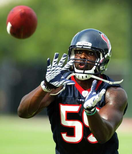 Top draft pick Whitney Mercilus has kept his eye on the ball and the task at hand in switching from college end to pro linebacker at the Texans' minicamp. Photo: Brett Coomer / © 2012 Houston Chronicle