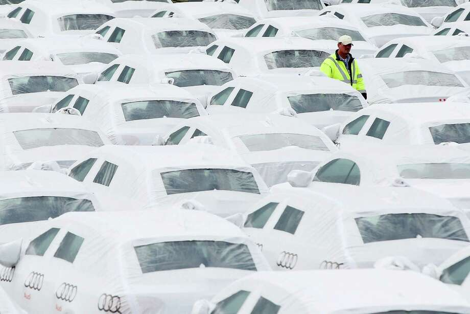 A customs officer checks Audi and Volkswagen cars destined for export before they are loaded onto a ship in Emden port on June 13, 2012 in Emden, Germany. Photo: Sean Gallup, Getty Images / 2012 Getty Images