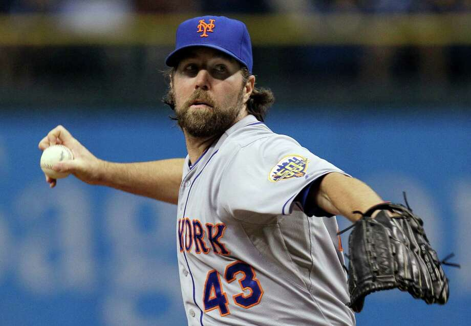 New York Mets starting pitcher R.A. Dickey delivers to the Tampa Bay Rays during the first inning of an interleague baseball game Wednesday, June 13, 2012, in St. Petersburg, Fla. (AP Photo/Chris O'Meara) Photo: Chris O'Meara
