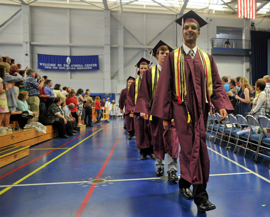 Class President Abdullah Hasan leads fellow classmates during the procession at the Bethel High School graduation in the O'Neill Center at Western Connecticut State University's westside campus on Wednesday, June 13, 2012. Photo: Jason Rearick / The News-Times