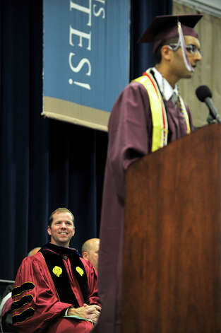 Superintendent of Bethel Schools Kevin Smith, left, listens to Class President Abdullah Hasan speak during the Bethel High School graduation in the O'Neill Center at Western Connecticut State University's westside campus on Wednesday, June 13, 2012. Photo: Jason Rearick / The News-Times