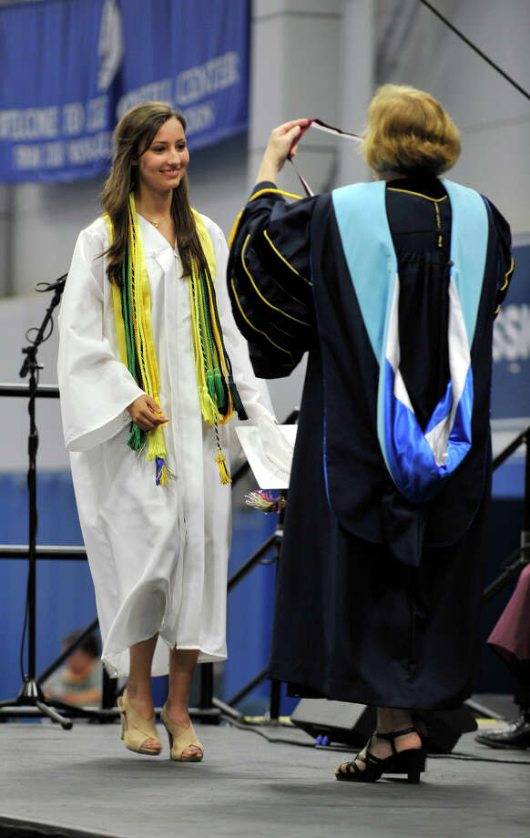 Claire Rodgers is awarded the salutatorian during the Bethel High School graduation in the O'Neill Center at Western Connecticut State University's westside campus on Wednesday, June 13, 2012. Photo: Jason Rearick / The News-Times