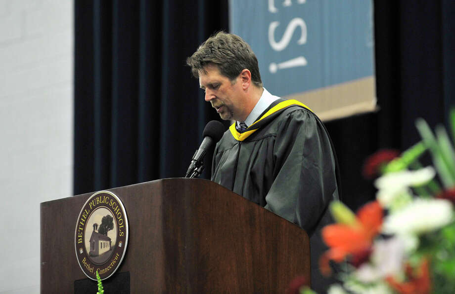 Asst. Principal Gary Lawlor speaks during the Bethel High School graduation in the O'Neill Center at Western Connecticut State University's westside campus on Wednesday, June 13, 2012. Photo: Jason Rearick / The News-Times