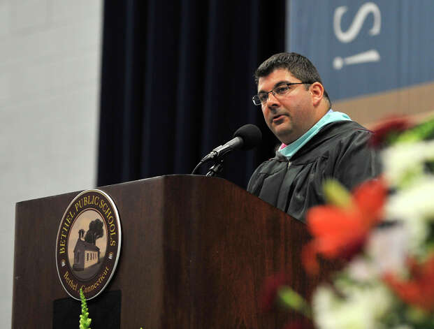 Asst. Principal Christopher Troetti speaks during the Bethel High School graduation in the O'Neill Center at Western Connecticut State University's westside campus on Wednesday, June 13, 2012. Photo: Jason Rearick / The News-Times