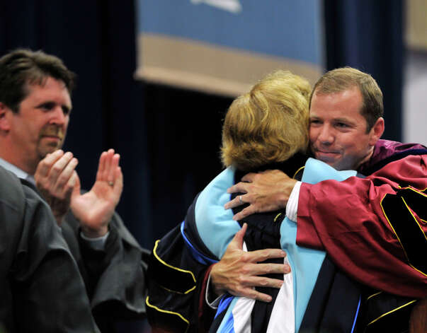 Bethel High School Principal Patricia Cosentino is hugged by Superintendent of Bethel Schools Kevin Smith during the Bethel High School graduation in the O'Neill Center at Western Connecticut State University's westside campus on Wednesday, June 13, 2012. Photo: Jason Rearick / The News-Times