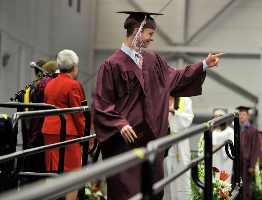 Sam Dolan waves to friends and family after receiving his diploma during the Bethel High School graduation in the O'Neill Center at Western Connecticut State University's westside campus on Wednesday, June 13, 2012. Photo: Jason Rearick / The News-Times