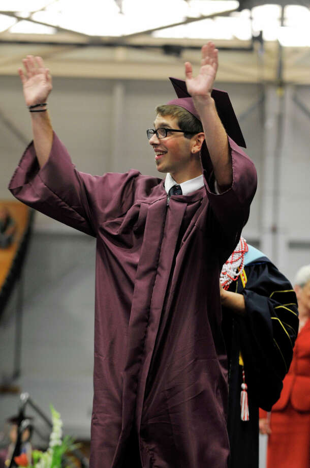 Jarrett Kellogg waves to friends and family as he receives his diploma during the Bethel High School graduation in the O'Neill Center at Western Connecticut State University's westside campus on Wednesday, June 13, 2012. Photo: Jason Rearick / The News-Times