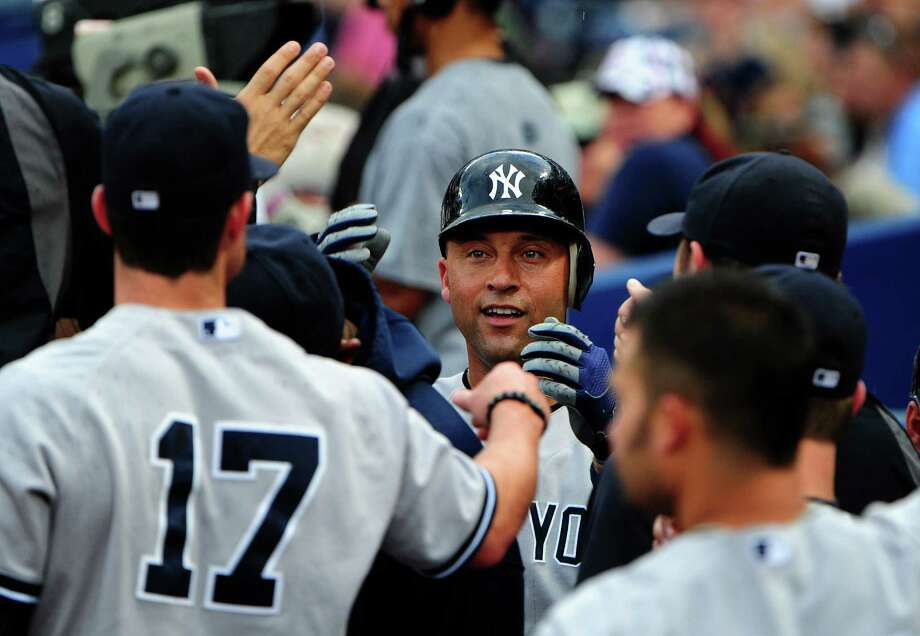 ATLANTA, GA - JUNE 13: Derek Jeter #2 of the New York Yankees is congratulated by teammates after scoring a first inning run against the Atlanta Braves at Turner Field on June 13, 2012 in Atlanta, Georgia. (Photo by Scott Cunningham/Getty Images) Photo: Scott Cunningham