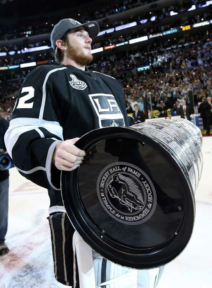 LOS ANGELES, CA - JUNE 11:  Goaltender Jonathan Quick #32 of the Los Angeles Kings holds the Stanley Cup after the Kings defeated the New Jersey Devils 6-1 to win the Stanley Cup in Game Six of the 2012 Stanley Cup Final at Staples Center on June 11, 2012 in Los Angeles, California.  (Photo by Bruce Bennett/Getty Images) Photo: Bruce Bennett, Getty Images / 2012 Getty Images