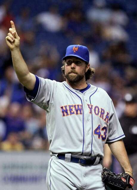 The Mets' R.A. Dickey celebrates after closing out a one-hitter in a 9-1 win over the host Rays. Dickey allowed only an infield single in the first inning. Photo: Chris O'Meara / AP