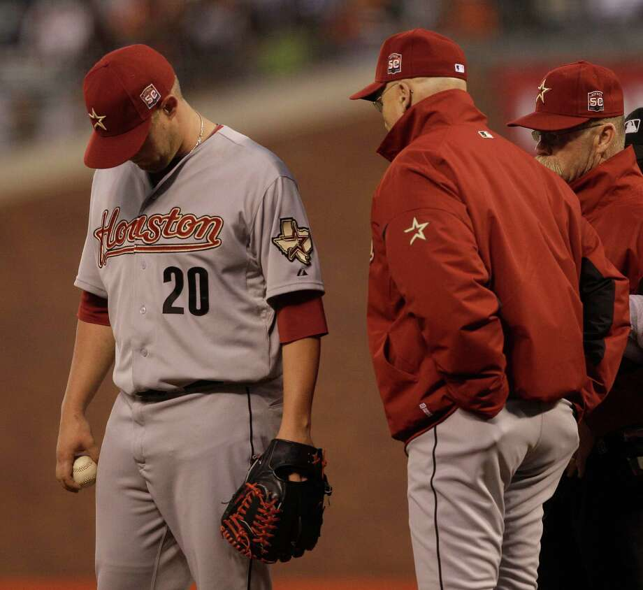 Astros starter Bud Norris knew it wasn't a good situation when he was approached by manager Brad Mills after being hurt in the fourth inning Tuesday. Photo: Jeff Chiu / AP