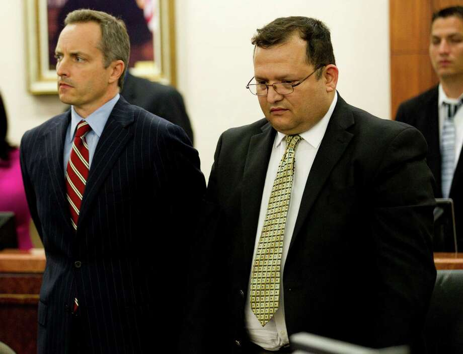 Raul Rodriguez, right, stands with his attorney Bill Stradley as he is found guilty of killing Kelly Danaher Wednesday, June 13, 2012, in Houston. Rodriguez, 47, was convicted of murder in the shooting death of Danaher, stemming from a 2010 incident where Rodriguez went to tell his neighbors to turn down the music at a party. He took a flashlight, a video camera and a gun. He claimed self defense in the shooting. ( Brett Coomer / Houston Chronicle ) Photo: Brett Coomer / © 2012 Houston Chronicle
