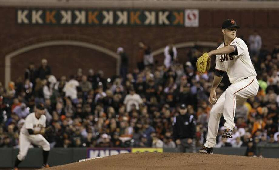 Giants pitcher Matt Cain delivers against the Astros during the seventh inning. (Jeff Chiu / Associated Press)