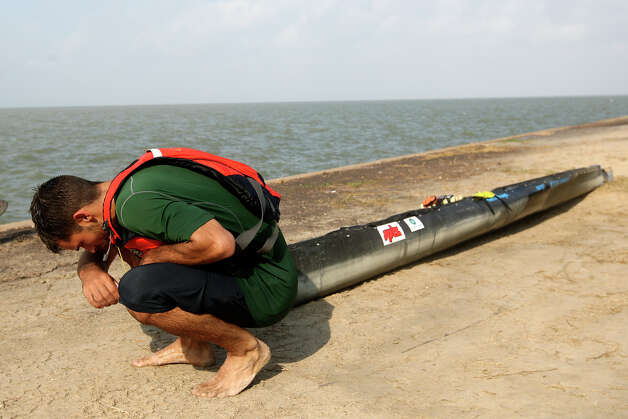 Exhausted, Andrew Condie, of Cuero, takes a breather while dragging his canoe the last quarter-mile after getting out of the San Antonio Bay during the during the 2012 Texas Water Safari canoe race, Monday, June 11, 2012. Allowed by rules, Condie was able to cross the finish line with his craft and place 12th overall. Photo: Jerry Lara, San Antonio Express-News / © 2012 San Antonio Express-News