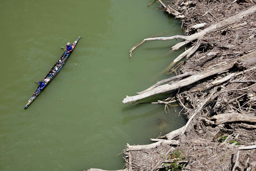 House of Blues team members Lauren DeLouche (front) and Michael Simmons navigate a logjam by the Thomaston River Road bridge over the Guadalupe River south of Cuero, during the 2012 Texas Water Safari canoe race, Monday, June 11, 2012. The race started in San Marcos on Saturday and ends at Seadrift, by San Antonio Bay. The House of Blues started as a three-member team but by the bridge they were down to two. The third member Jeanette Burris became ill and was taken to an area hospital by her daughter, accoridng to a family team member. She was checked and released later. Competitors have until Wednesday to complete the 260-mile course.