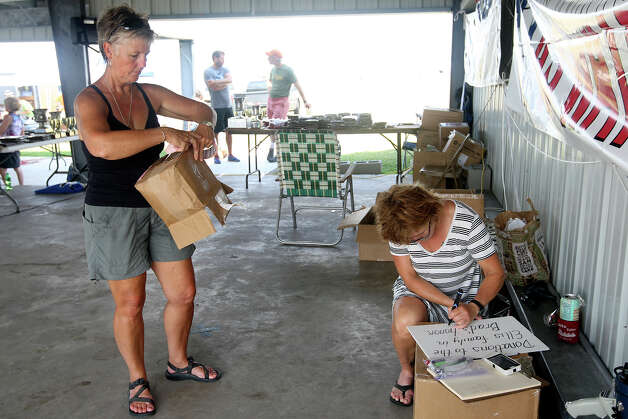 Joy Emshoff (left) and Ginsie Stauss make a donation box for the family of Brad Ellis before the start of the 2012 Texas Water Safari awards ceremony in Seadrift, Wednesday, June 13, 2012. A prayer for Brad Ellis, 30, was included during the event. Ellis died Monday afternoon after falling ill during the race early Sunday morning. He died of hyponatremia or low sodium in his system. Photo: Jerry Lara, San Antonio Express-News / © 2012 San Antonio Express-News
