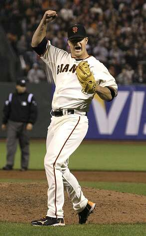 Matt Cain exults after recording the final out. Photo: Jeff Chiu, Associated Press