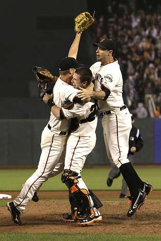 Matt Cain (left) celebrates with Buster Posey and Brandon Belt after the final out was secured. Photo: Jeff Chiu, Associated Press