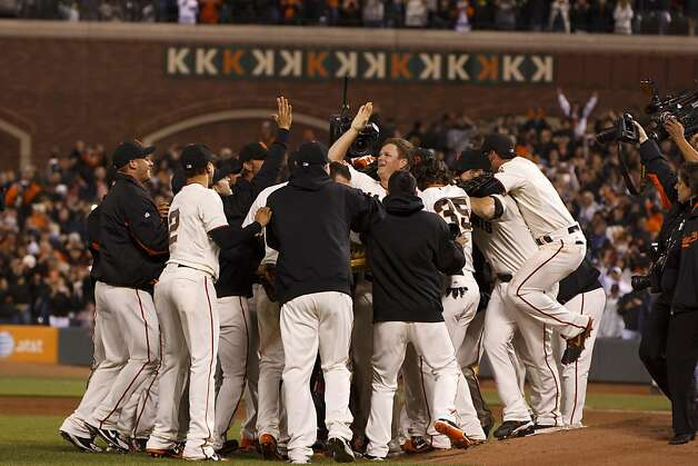 Matt Cain #18 of the San Francisco Giants celebrates after pitching a perfect game against the Houston Astros at AT&T Park on June 13, 2012 in San Francisco, California. The San Francisco Giants defeated the Houston Astros 10-0. Matt Cain struck out a career-high 14 batters, and pitched a perfect game in what was the first in Giants franchise history. Photo: Jason O. Watson, Getty Images