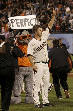 San Francisco Giants pitcher Matt Cain celebrates after the final out of the ninth inning of a baseball game against the Houston Astros in San Francisco, Wednesday, June 13, 2012. Cain pitched the 22nd perfect game in major league history and first for the Giants, striking out a career-high 14 and getting help from two spectacular catches to beat the Houston Astros 10-0. Photo: Jeff Chiu, Associated Press