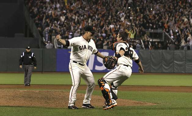 San Francisco Giants pitcher Matt Cain, left, celebrates with catcher Buster Posey after the final out of the ninth inning of a baseball game against the Houston Astros in San Francisco, Wednesday, June 13, 2012. Cain pitched the 22nd perfect game in major league history and first for the Giants, striking out a career-high 14 and getting help from two spectacular catches to beat the Houston Astros 10-0. Photo: Jeff Chiu, Associated Press