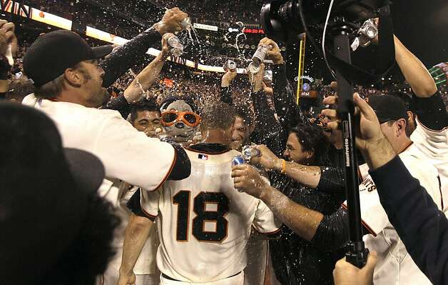 San Francisco Giants pitcher Matt Cain (18) celebrates with teammates after throwing a perfect game in a baseball game against the Houston Astros in San Francisco, Wednesday, June 13, 2012. Cain pitched the 22nd perfect game in major league history and first for the Giants, striking out a career-high 14 and getting help from two spectacular catches to beat the Houston Astros 10-0. Photo: Jeff Chiu, Associated Press