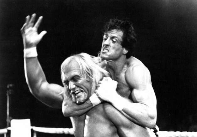 Early in 'Rocky II,' from 1982, Rocky takes on wrestling champion Thunderlips (wrestler Hulk Hogan) in a goofy charity match in which each man throws the other out of the ring.